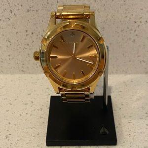 "Nixon ""the Camden"" gold watch with diamond"